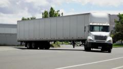 Semi-truck, 18 wheeler big rig, pulls out in traffic, 1005  Stock Footage