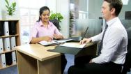 Stock Video Footage of Female Asian Indian Recruitment Manager Male Applicant