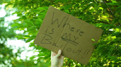 Bailout protest sign protesting Stock Footage