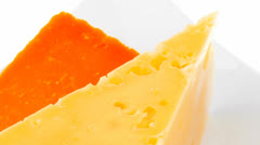 Two pieces of french gourmet cheeses Stock Footage