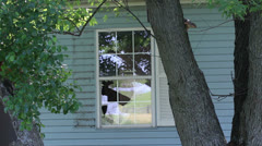 Broken window crime condemned house Stock Footage