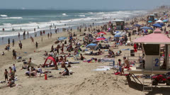 Crowded Beach at Huntington Beach, Ca Stock Footage