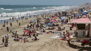 Stock Video Footage of Crowded Beach at Huntington Beach, Ca
