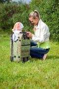 girl and child in valise.family  to journey - stock photo