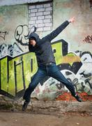 cool looking dancer posing on a grunge background - stock photo
