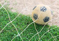 Stock Photo of classic soccer ball on green grass