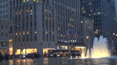 Beautiful water fountain in Midtown Manhattan traffic street, New York City, USA Stock Footage