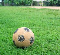classic soccer ball on green grass - stock photo