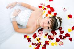 Beautiful sexy bride on  floor a Stock Photos
