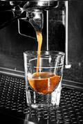 Espresso Coffee Extraction With A Professional Machine Stock Photos