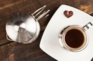 Elegant Coffee Cup Served Along With Filter Against Heavy Polished Wooden Table Stock Photos