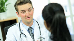 Male Doctor Showing Patient Medical Test Results - stock footage