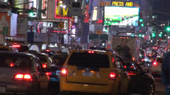 Heavy taxi traffic by night Times Square, Manhattan, New York ,  NYC, USA Stock Footage