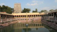India Tamil Nadu Madurai temple tank and central columns w wailing music 2 Stock Footage