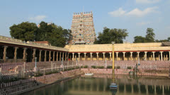 India Tamil Nadu Madurai temple tank and reflected columns w bell sound 1 Stock Footage