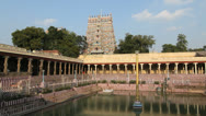 Stock Video Footage of India Tamil Nadu Madurai temple tank and reflected columns w bell sound 1