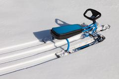 snow scooter or snowmobile toy - stock photo