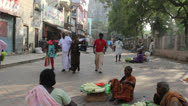 Stock Video Footage of India Tamil Nadu Madurai seated vendors in robes and gopuram 6