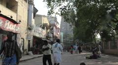 India Tamil Nadu Madurai temple shadowy gopuram from crowded street 5 Stock Footage