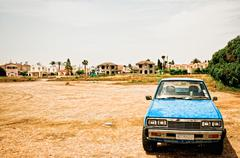 Old blue car parked in a desolate scenery in Cyprus Stock Photos