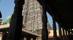 India Tamil Nadu Madurai temple gopuram through columns Stock Footage