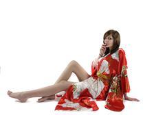 Stock Photo of french young girl geisha in red silk kimono