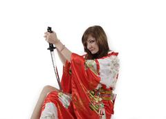 French young girl geisha in red silk kimono with japanese sword Stock Photos