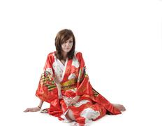 Stock Photo of french young girl geisha in red silk kimono