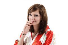French young girl geisha in red silk kimono Stock Photos