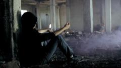 Man Abusing Drugs in Abandoned Building Smoke Crane Shot HD  - stock footage