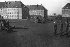 WW2 - German artillery barracks, recruits and cannons - stock photo