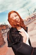 Woman portrait, windy city Stock Photos