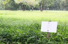 White signboard on grass field Stock Photos
