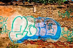 graffiti - vandalized rural wall - stock photo