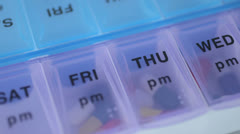 Close-Up of daily pill box Stock Footage