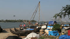 India Kerala Cochin harbor canoes and Chinese fishing net frame 39 Stock Footage
