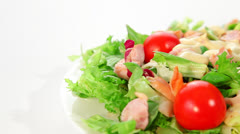 Salad with lettuce, tomato and chicken dolly shot Stock Footage