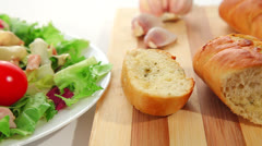 Salad with chicken and garlic bread - stock footage