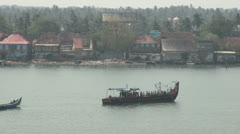 India Kerala Cochin harbor crowded tour boat and traditional boat 12 - stock footage