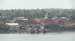 India Kerala Cochin neatly painted trawlers at rustic dock 23 Stock Footage