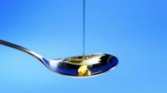 Honey pouring into a spoon Stock Footage