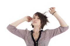young brunette woman playing mannequin hand in hair - stock photo