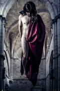 nude magician levitating inside a gothic cathedral - stock photo