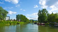 Wide shot of Ljubljanica under blue sky Stock Footage