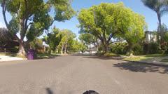 Riding Bicycle On Idyllic Suburban Street Past Nice Homes Stock Footage