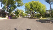 Stock Video Footage of Riding Bicycle On Idyllic Suburban Street Past Nice Homes