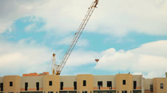 Crane above the roof, pulling cargo transports Stock Footage