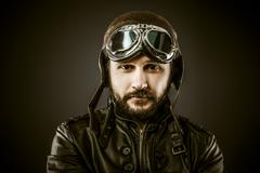 Stock Photo of proud, fighter pilot with hat and glasses era, vintage style