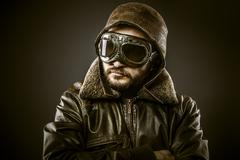 Stock Photo of fighter pilot with hat and glasses era, vintage