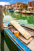 boat on canal in murano - stock photo